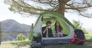 Smiling people having rest in tent stock footage