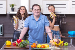 Smiling people  at kitchen Stock Photography