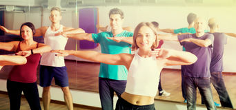 Smiling people learning zumba steps Royalty Free Stock Image