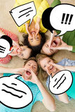Smiling people lying down on floor and screaming. Friendship, lifestyle and happiness concept - group of young smiling people lying on floor in circle screaming Royalty Free Stock Image