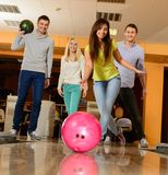 Smiling people playing bowling Stock Images