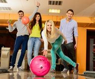 Smiling people playing bowling Stock Photo