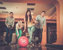 Smiling people playing bowling Stock Image
