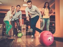Smiling people playing bowling Stock Photos