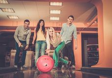 Smiling people playing bowling Stock Photography