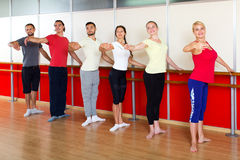 Smiling people rehearsing ballet dance Royalty Free Stock Image