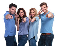 Smiling people talking on the phone and pointing fingers Royalty Free Stock Image