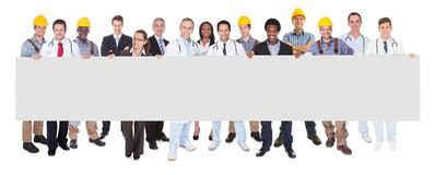 Smiling people with various occupations holding blank billboard Stock Photo