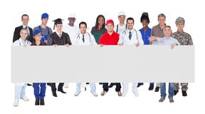 Smiling people with various occupations holding blank billboard Royalty Free Stock Photography