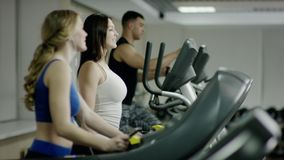 Smiling people walking on treadmill stock video footage