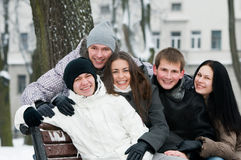 Smiling people in warm clothing at Stock Image