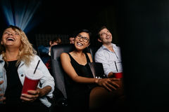 Smiling people watching comedy film in theater Royalty Free Stock Photo