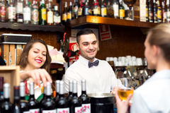 Smiling people working in a bar stock photos