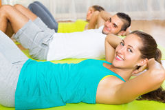 Smiling people working in gym Royalty Free Stock Images