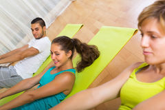 Smiling people working in gym Royalty Free Stock Photo