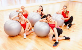 Smiling people working out in pilates class Stock Image