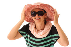 Smiling person adjusting straw sun hat Stock Image