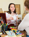 Smiling person painting image. At workspace Stock Photo
