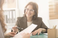 Smiling personal health coach stock image