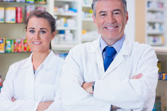 smiling pharmacist and his trainee with arms crossed stock photos - Pharmacist Trainee