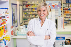Smiling pharmacist in lab coat looking at camera Royalty Free Stock Photos