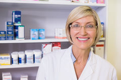 Smiling pharmacist in lab coat looking at camera Stock Photos