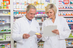 Smiling pharmacists team talking about medication Stock Images