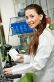 Smiling Pharmacy chemist woman in drugstore Royalty Free Stock Photos