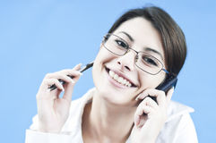 Smiling at the phone Royalty Free Stock Photos