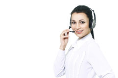 Smiling phone operator in headphones with microphone, holding the   his hand. Stock Photography