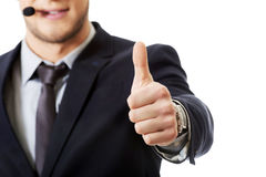 Smiling phone operator with thumbs up. Stock Photos