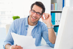 Smiling photo editor at work holding contact sheet. In office royalty free stock images