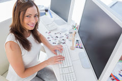 Smiling photo editor at work Royalty Free Stock Image