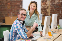 Smiling photo editors in office Royalty Free Stock Photo