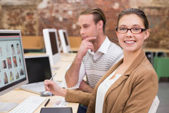 Smiling photo editors using computer in office Royalty Free Stock Images
