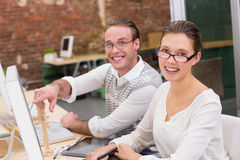 Smiling photo editors using computer in office Royalty Free Stock Photos