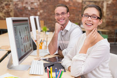 Smiling photo editors using computers in office Royalty Free Stock Photography