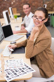 Smiling photo editors using computers in office Stock Photo