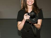 Smiling photographer and camera with big lens stock photos
