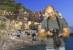 Smiling photographer in cinque terre italy stock photo