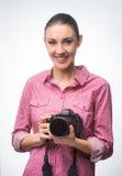 Smiling photographer with digital camera Stock Photos