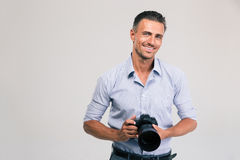 Smiling photographer holding camera royalty free stock photo