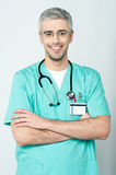 Smiling physician, arms crossed. Smiling senior doctor with stethoscope Stock Photo