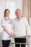 Smiling physician and senior man Royalty Free Stock Photo