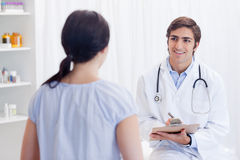Smiling physician talking with patient Royalty Free Stock Photos