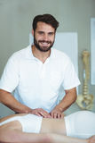 Smiling physiotherapist giving back massage to a woman Royalty Free Stock Photo