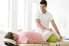 Physiotherapist supporting senior woman Stock Photo