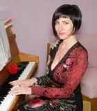 Smiling pianist Stock Photo