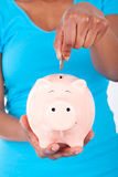 Smiling  Piggy bank with euro bills Royalty Free Stock Images