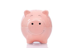 Smiling Piggy bank  on white background Royalty Free Stock Photography
